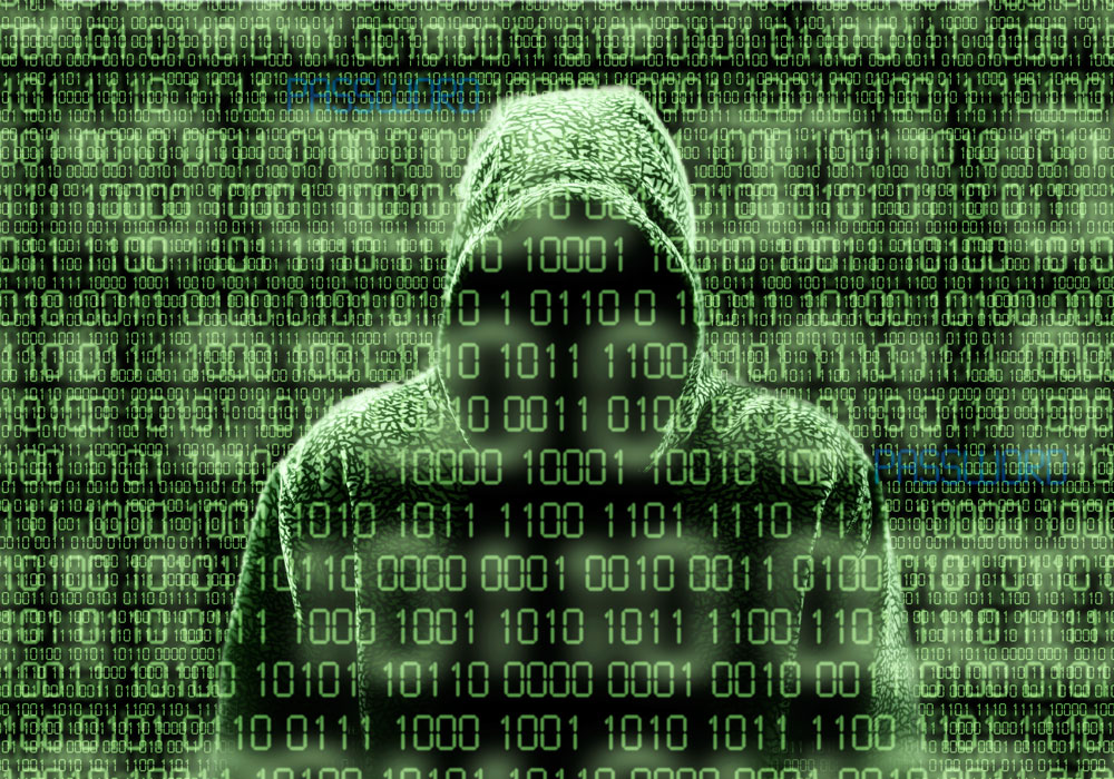 Binary code layer with person wearing a hoodie in the background