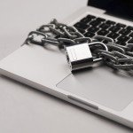 Sliver laptop warped in heavy chains attached with lock