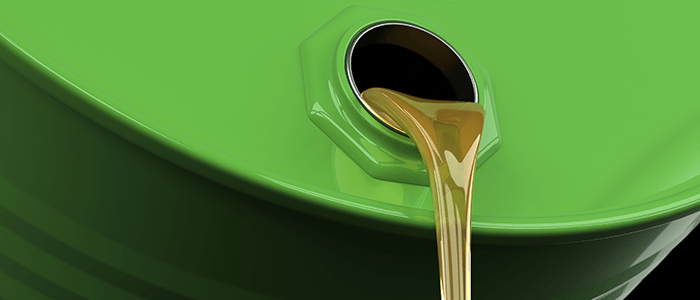 oil waste pouring from an oil drum
