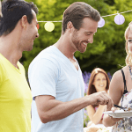 Happy employees safely enjoying company Barbecue party