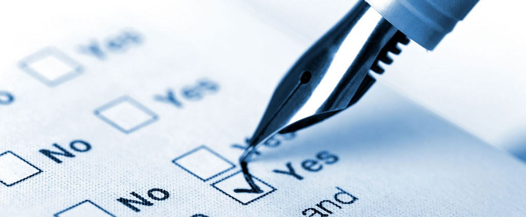A pen checking off a yes and no checklist