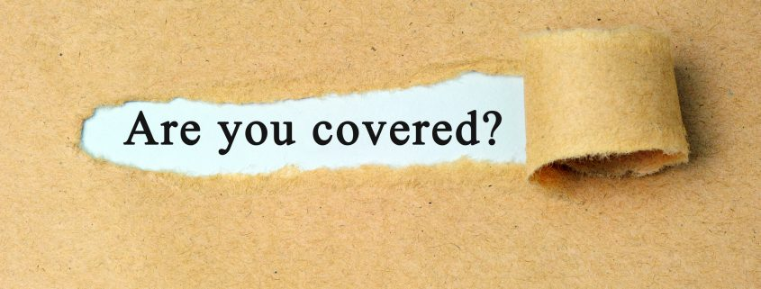 """A ripped piece of brown paper to reveal the words """"are you covered"""" typed underneath"""