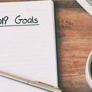 Opened notebook with 2019 Goals written and numbered list below.