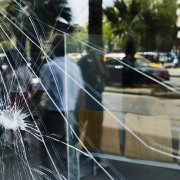 Close up of cracked storefront window in Hamilton