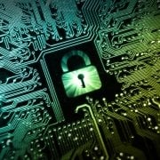 Green digital padlock on green and black motherboard