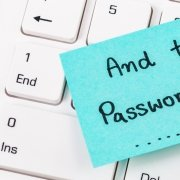 "Blue sticky note on white laptop reading ""and the password is......"""