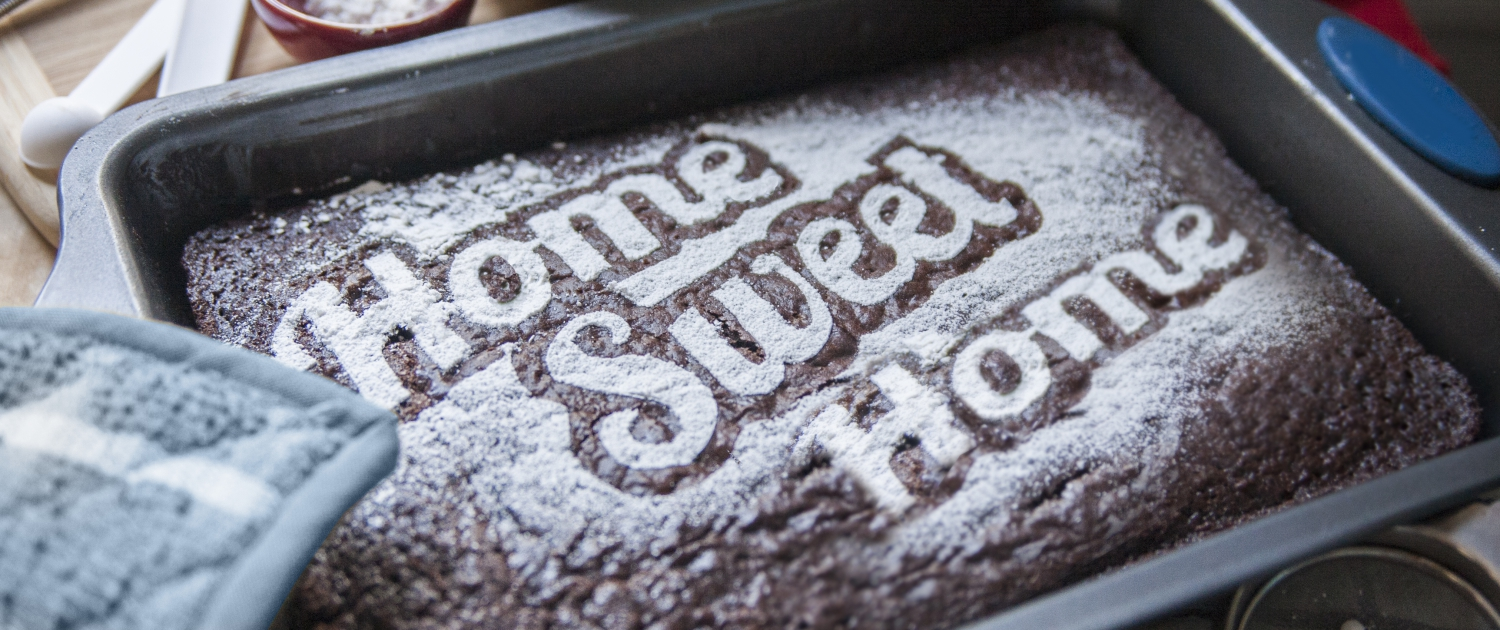 Brownie dusted with powdered sugar reading home sweet home