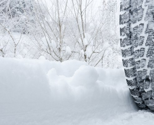 winter tire on snow covered road