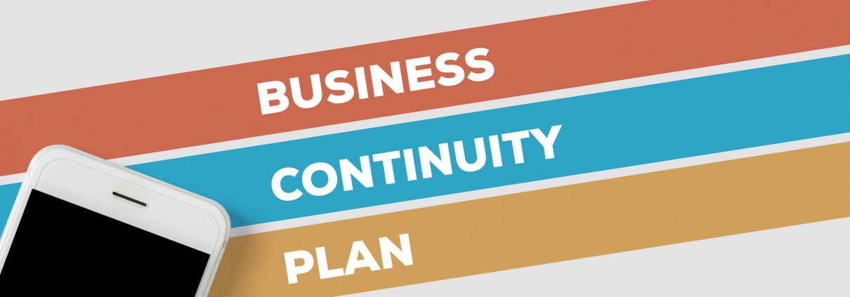 Business continuity plan in white text over red, blue and yellow lines with mobile device in bottom left corner