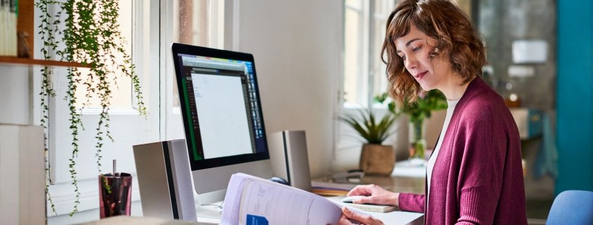 A woman working in her home office.