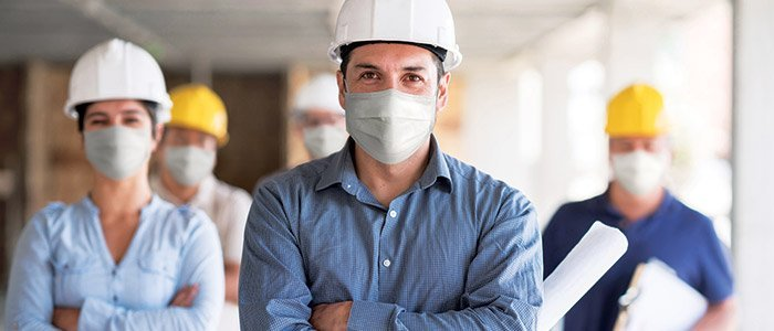 Construction workers and contractors wearing protective face masks